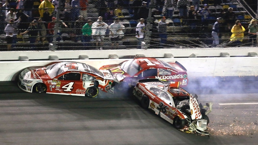 Kevin Harvick (4), Jamie McMurray (1) and Reed Sorenson (36) crash on the front stretch on the last lap of the Daytona 500 NASCAR Sprint Cup Series auto race at Daytona International Speedway in Daytona Beach, Fla., Sunday, Feb. 23, 2014. (AP Photo/John Raoux)