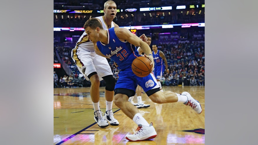 Los Angeles Clippers forward Blake Griffin (32) tries to get around New Orleans Pelicans center Greg Stiemsma (34) in the first half of an NBA basketball in New Orleans, Monday, Feb. 24, 2014. (AP Photo/Bill Haber)
