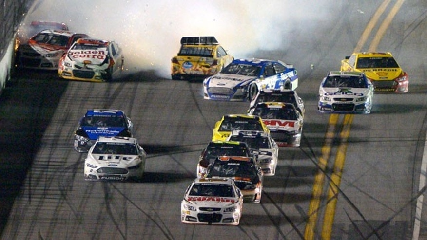 February 23, 2014: Dale Earnhardt Jr. (88) escapes a final lap wreck and leads to win the NASCAR Daytona 500 auto race at Daytona International Speedway in Daytona Beach, Fla. (AP Photo/Phelan M. Ebenhack)