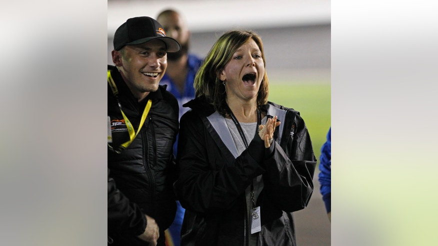 Kelley Earnhardt Miller, right, celebrates after her brother, Dale Earnhardt Jr, wins the NASCAR Daytona 500 Sprint Cup series auto race at Daytona International Speedway in Daytona Beach, Fla., Sunday, Feb. 23, 2014. (AP Photo/Terry Renna)