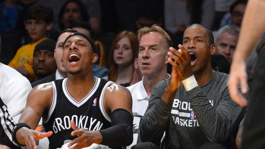 Brooklyn Nets forward Paul Pierce, left, and center Jason Collins cheer from the bench after the team scored during the first half of an NBA basketball against the Los Angeles Lakers, Sunday, Feb. 23, 2014, in Los Angeles. (AP Photo/Mark J. Terrill)