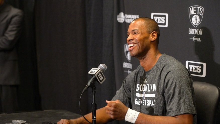 Brooklyn Nets center Jason Collins speaks during a news conference prior to an NBA basketball game against the Los Angeles Lakers, Sunday, Feb. 23, 2014, in Los Angeles. Collins signed a 10-day contract with the Brooklyn Nets earlier Sunday and was to be in uniform for their game in Los Angeles against the Lakers. The 35-year-old center revealed at the end of last season he is gay, but he was a free agent and had remained unsigned. (AP Photo/Mark J. Terrill)