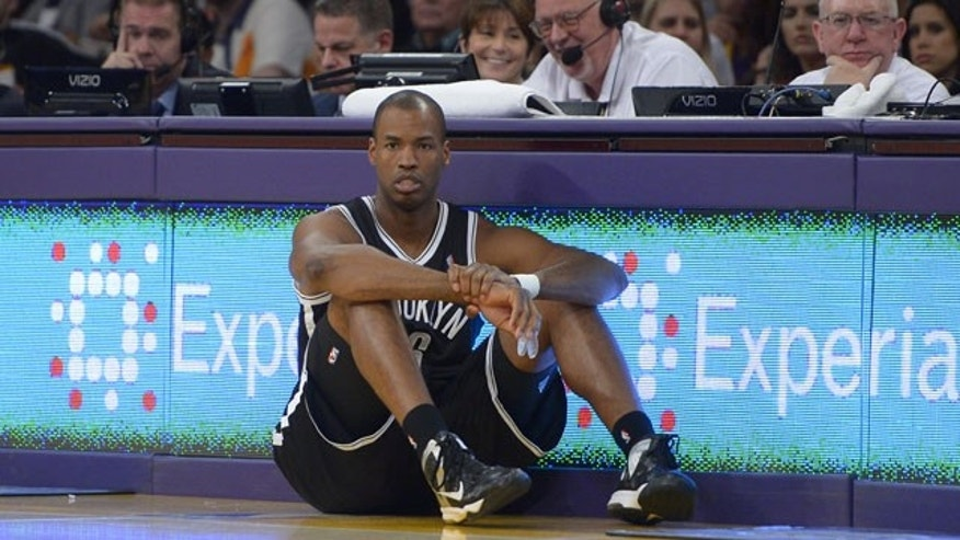 February 23, 2014: Brooklyn Nets center Jason Collins waits to come into the game during the second half of an NBA basketball game against the Los Angeles Lakers. The Nets won 108-102. (AP Photo/Mark J. Terrill)