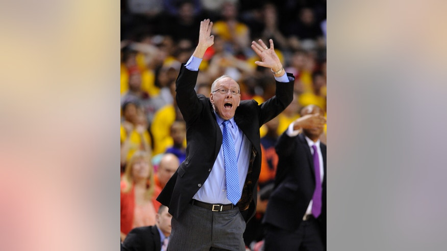 Syracuse head coach Jim Boeheim gestures during the second half of an NCAA college basketball game against Maryland, Monday, Feb. 24, 2014, in College Park, Md. Syracuse won 57-55. (AP Photo/Nick Wass)