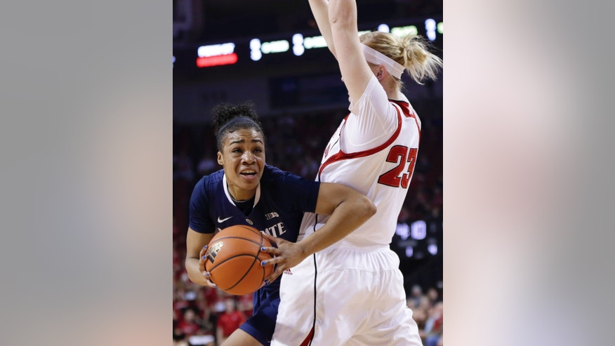 Penn State's Ariel Edwards, left, tries to get around Nebraska's Emily Cady (23) in the first half of an NCAA college basketball game in Lincoln, Neb., Monday, Feb. 24, 2014. (AP Photo/Nati Harnik)