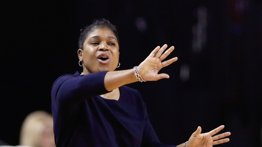 Penn State head coach Coquese Washington signals her players in the first half of an NCAA college basketball game against Nebraska in Lincoln, Neb., Monday, Feb. 24, 2014. (AP Photo/Nati Harnik)