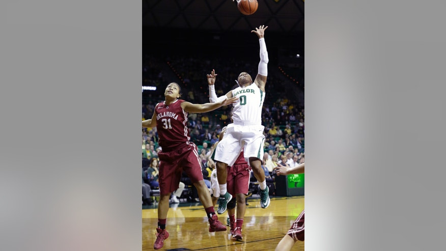 Baylor guard Odyssey Sims (0) shoots against Oklahoma forward Portia Durrett (31) during the first half of an NCAA college basketball game, Monday, Feb. 24, 2014, in Waco, Texas. (AP Photo/LM Otero)