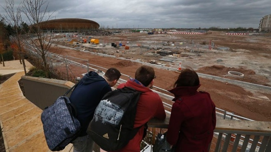Feb. 23, 2014: In this photo, people take a look at the construction site in Queen Elizabeth Olympic Park in east London. The Games' Velodrome is seen left. London continues to bask in the success of the most recent Summer Games, but the Olympic legacy is difficult to determine. The flagship venue, renamed the Queen Elizabeth Olympic Park, is being converted into a massive park as big as Londons famous Hyde Park, complete with wildlife habitats, woods and sports facilities. The first part of the ambitious project will begin to open to the public in April.