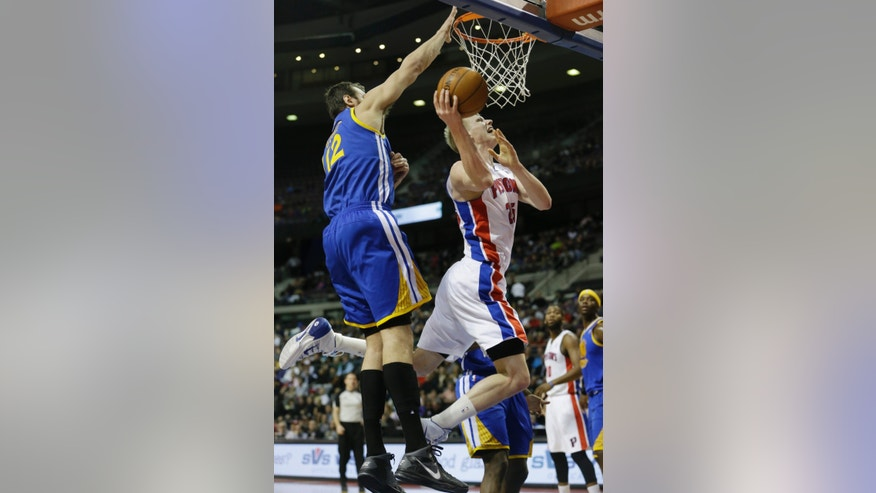 Detroit Pistons forward Kyle Singler (25) shoots while defended by Golden State Warriors center Andrew Bogut (12) during the first half of an NBA basketball game in Auburn Hills, Mich., Monday, Feb. 24, 2014. (AP Photo/Carlos Osorio)