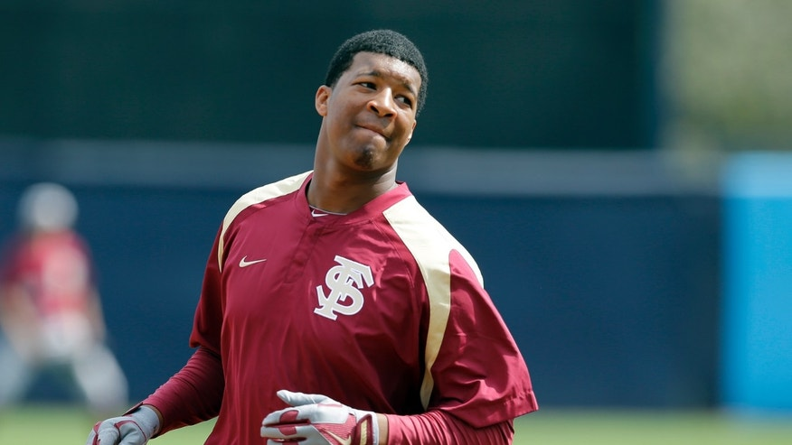 Florida State's Jameis Winston runs the bases during batting practice before a spring training exhibition game against the New York Yankees Tuesday, Feb. 25, 2014, in Tampa, Fla. Winston is the 2013 Heisman Trophy winner. (AP Photo/Chris O'Meara)