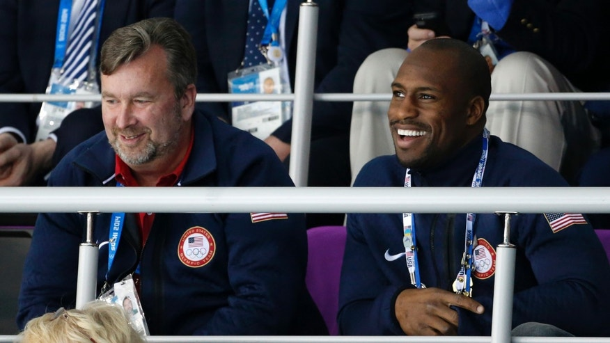 FILE - In this Feb. 15, 2014, file photo, San Francisco 49ers tight end Vernon Davis, right, attends women's curling competition at the 2014 Winter Olympics in Sochi, Russia. After a quick trip to the Sochi Olympics as USA Curling's honorary captain, 49ers tight end Vernon Davis is back in the Bay Area gearing up for a busy offseason of training and activities when he begins his regular routine in the coming weeks. (AP Photo/Robert F. Bukaty, File)