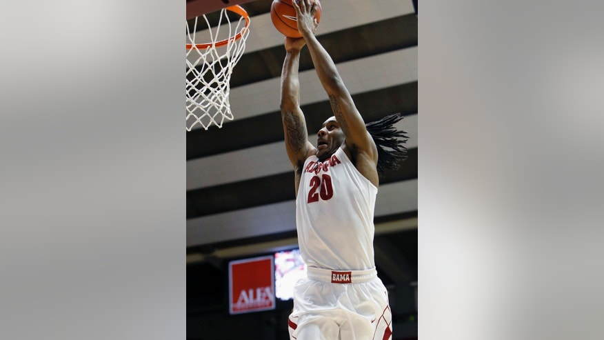 Alabama's Levi Randolph (20) dunks in the first half of an NCAA college basketball game against Missouri, Saturday, Feb. 22, 2014, in Tuscaloosa, Ala. (AP Photo/The Tuscaloosa News, Dusty Compton)
