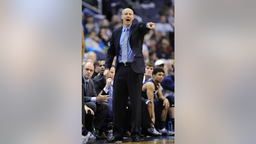 Xavier head coach Chris Mack points during the second half of an NCAA college basketball game against Georgetown, Saturday, Feb. 22, 2014, in Washington. Georgetown won 74-52. (AP Photo/Nick Wass)