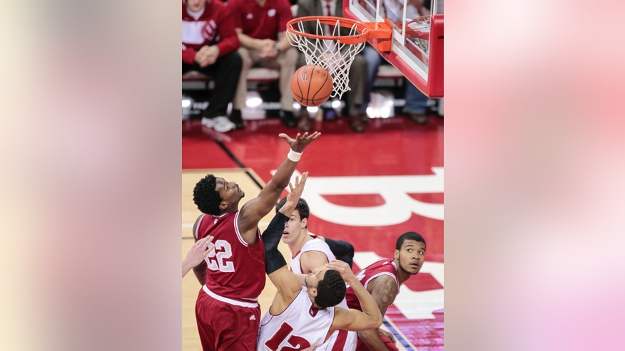 Indiana's Stanford Robinson (22) shoots against Wisconsin's Traevon Jackson (12) during the first half of an NCAA college basketball game, Tuesday, Feb. 25, 2014, in Madison, Wis. (AP Photo/Andy Manis)