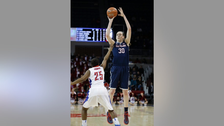 Connecticut forward Breanna Stewart (30) shoots against SMU guard Krystal Johnson (25) during the first half of an NCAA college basketball game, Tuesday, Feb. 25, 2014, in Dallas. (AP Photo/LM Otero)
