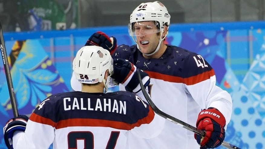 Feb. 19, 2014: USA forward David Backes (42) celebrates his goal against the Czech Republic with teammate Ryan Callahan during the first period of men's quarterfinal hockey game in Shayba Arena at the 2014 Winter Olympics in Sochi, Russia.