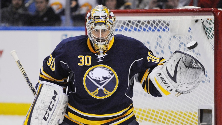 Buffalo Sabres goaltender Ryan Miller reaches out with his glove to stop the puck during the second period of an NHL hockey game against the Carolina Hurricanes in Buffalo, N.Y., Tuesday, Feb. 25, 2014. Buffalo won 3-2. (AP Photo/Gary Wiepert)