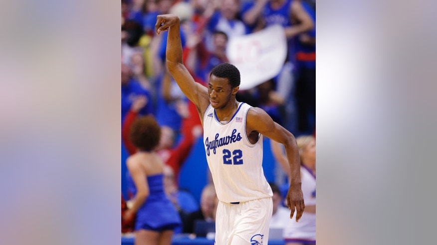 Kansas guard Andrew Wiggins (22) celebrates a three-point basket during the second half of an NCAA college basketball game against Oklahoma in Lawrence, Kan., Monday, Feb. 24, 2014. Wiggins scored 15 points in the game. Kansas defeated Oklahoma 83-75. (AP Photo/Orlin Wagner)