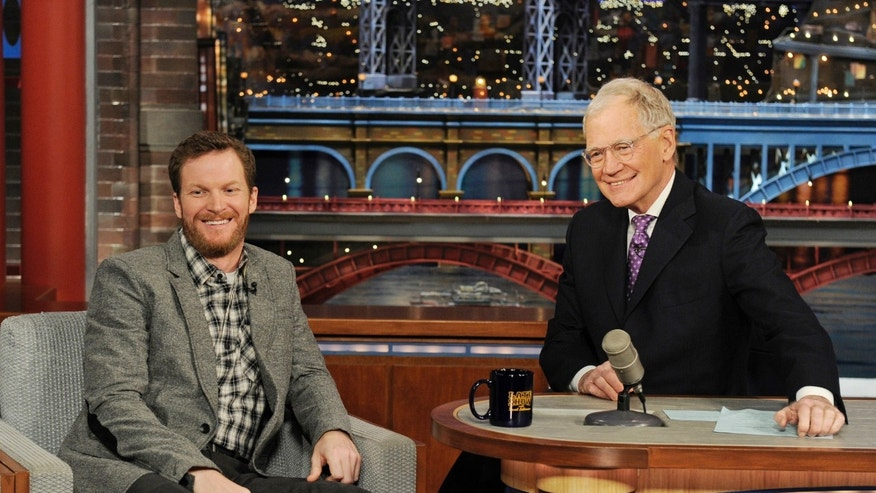 "In this Monday, Feb. 24, 2014 photo provided by CBS, Daytona 500 winner Dale Earnhardt Jr., left, joins host David Letterman on the set of the ""Late Show with David Letterman""  in New York. Earnhardt discussed winning his second Daytona 500. (AP Photo/CBS, Jeffrey R. Staab) MANDATORY CREDIT, NO SALES, NO ARCHIVE, FOR NORTH AMERICAN USE ONLY"