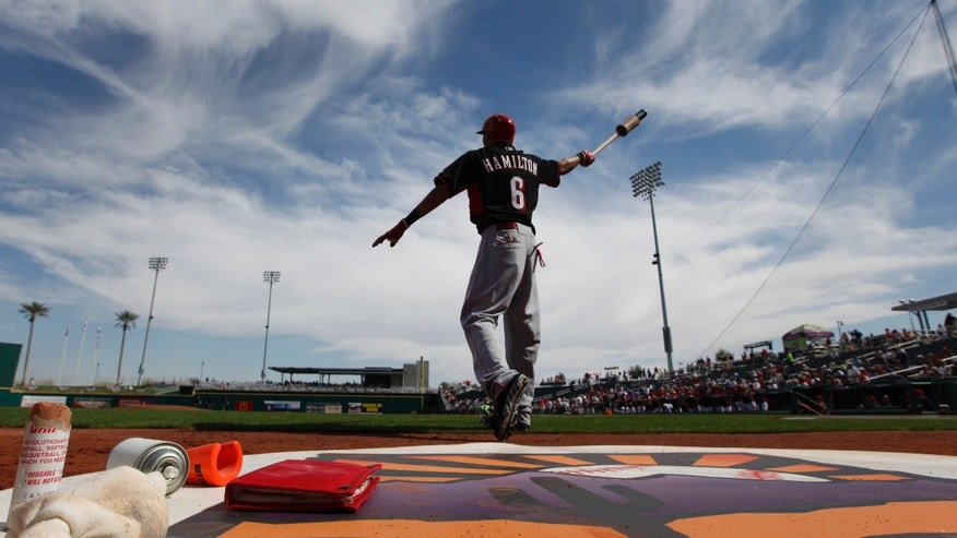 Cincinnati Reds' Billy Hamilton swings a bat in the on-deck circle before the first inning of an exhibition baseball game against the Cleveland Indians in Goodyear, Ariz., Wednesday, Feb. 26, 2014. (AP Photo/Paul Sancya)