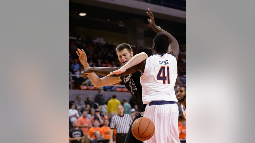 South Carolina forward Laimonas Chatkevicius (14) loses the ball under the basket defended by Auburn center Matthew Atewe (41), Wednesday, Feb. 26, 2014, during an NCAA college basketball game at Auburn Arena in Auburn, Ala. (AP Photo/The Birmingham News, Julie Bennett)