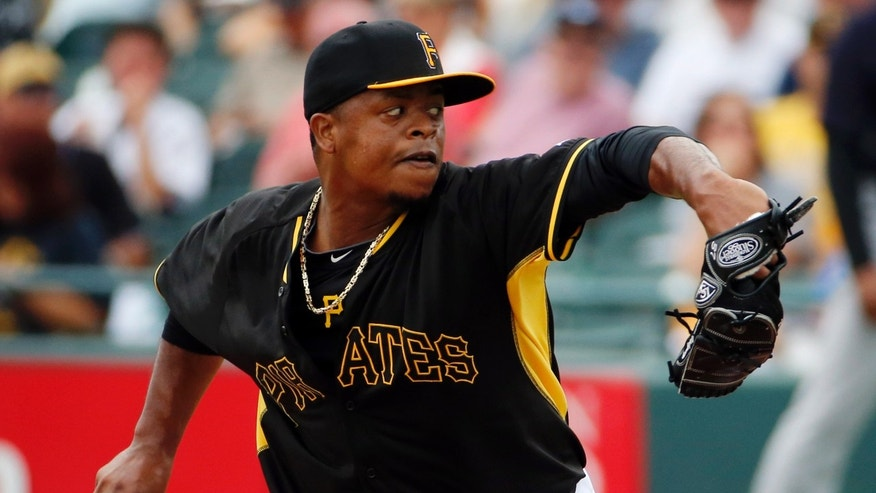 Pittsburgh Pirates pitcher Edinson Volquez throws in the second inning of an exhibition spring training baseball game against the New York Yankees in Bradenton, Fla., Wednesday, Feb. 26, 2014. The Pirates won 6-5. (AP Photo/Gene J. Puskar)
