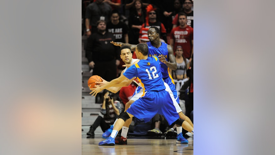 San Jose State's Rashad Muhammad (0) and Jalen James (12) double team San Diego State's JJ O'Brien (20) during the first half of an NCAA college basketball game on Tuesday, Feb. 25, 2014, in San Diego. (AP Photo/Denis Poroy)