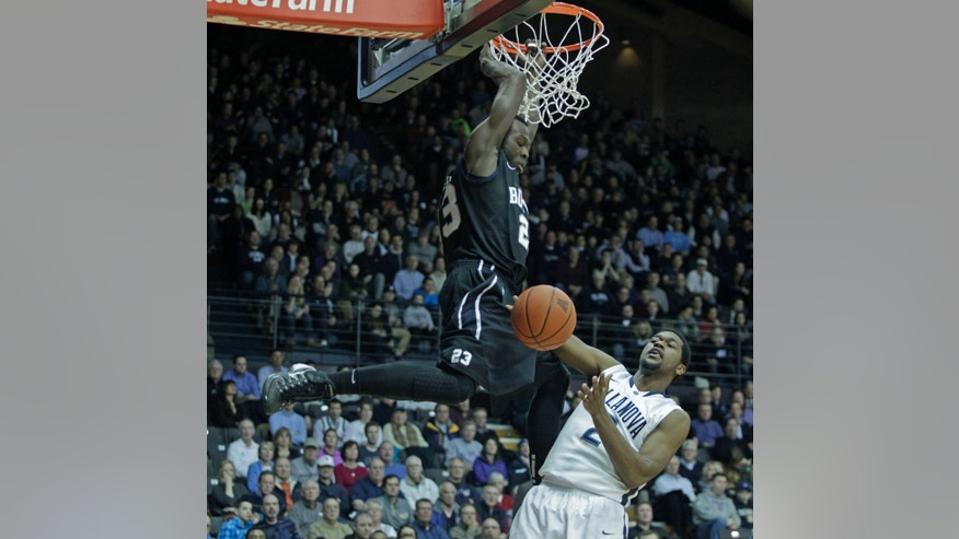 Butler's Khyle Marshall (23) scores as Villanova's Kris Jenkins (2) attempts to defend in the first half of an NCAA college basketball game on Wednesday, Feb. 26, 2014 in Villanova, Pa. (AP Photo/H. Rumph Jr.)