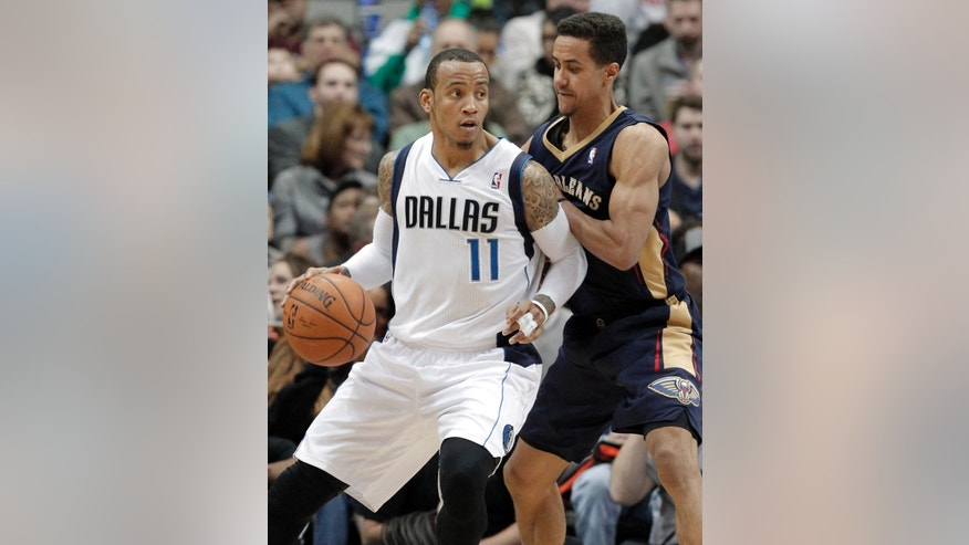 Dallas Mavericks' guard Monta Ellis (11) battles New Orleans Pelicans' Brian Roberts (22) for space during the second half of an NBA basketball game on Wednesday, Feb. 26, 2014, in Dallas. Dallas won 108-89. (AP Photo/Brandon Wade)