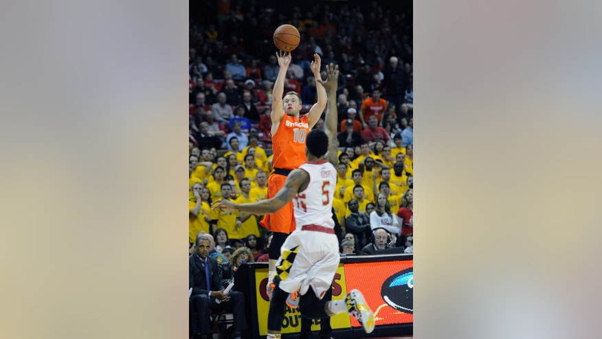 Syracuse guard Trevor Cooney (10) shoots as Maryland guard Nick Faust (5) defends during the first half of an NCAA college basketball game, Monday, Feb. 24, 2014, in College Park, Md. (AP Photo/Nick Wass)