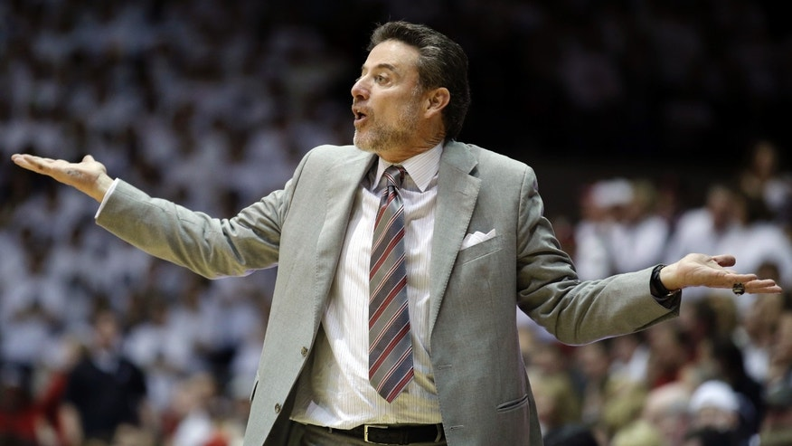 Louisville head coach Rick Pitino reacts to a play in the second half of an NCAA college basketball game against Cincinnati, Saturday, Feb. 22, 2014, in Cincinnati. Louisville won 58-57. (AP Photo/Al Behrman)