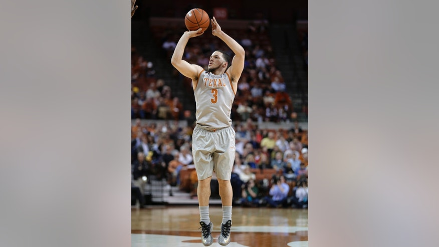 Texas' Javan Felix shoots a 3-pointer against Baylor during the first half of an NCAA college basketball game, Wednesday, Feb. 26, 2014, in Austin, Texas. (AP Photo/Eric Gay)
