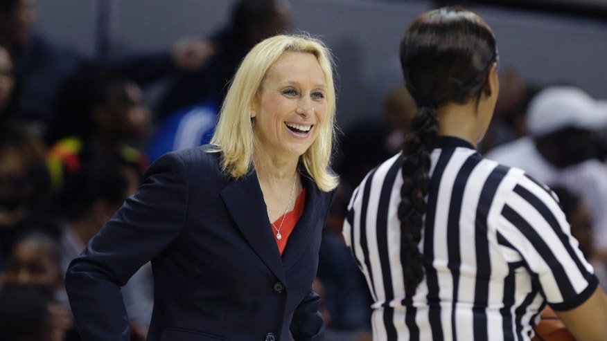 SMU head coach Rhonda Rompolas smiles as she questions a call during the first half of an NCAA college basketball game against Connecticut  Tuesday, Feb. 25, 2014, in Dallas. (AP Photo/LM Otero)