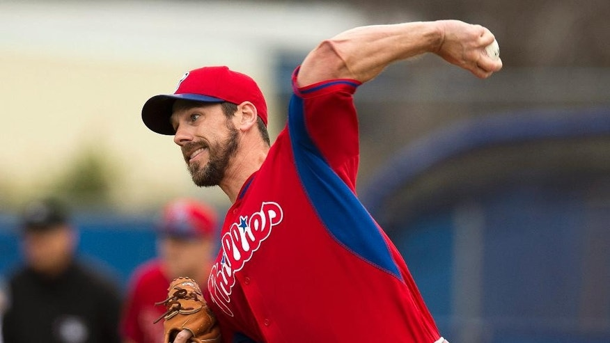 Philadelphia Phillies starting pitcher Cliff Lee pitches in first inning against the Toronto Blue Jays in an exhibition baseball game in Dunedin, Fla.,  Thursday Feb. 27, 2014. (AP Photo/The Canadian Press, Frank Gunn)