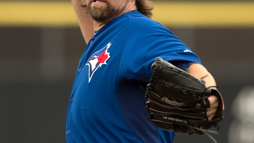 Toronto Blue Jays starter R.A. Dickey throws a warmup pitch in first inning against the Philadelphia Phillies in an exhibition baseball game in Dunedin, Fla.,  Thursday Feb. 27, 2014. (AP Photo/The Canadian Press, Frank Gunn)