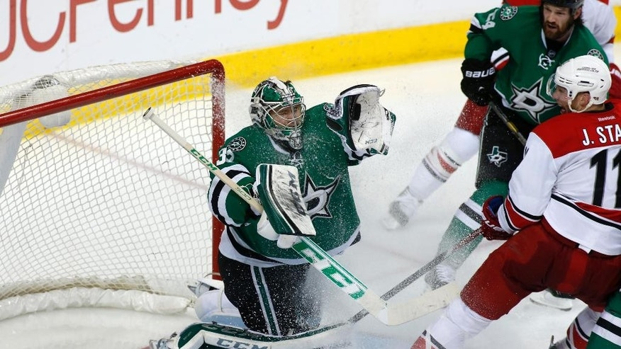 Dallas Stars goalie Kari Lehtonen (31), of Finland, makes the save as defenseman Jordie Benn (24) and Carolina Hurricanes center Jordan Staal (11) watch during the second period of an NHL hockey game on Thursday, Feb. 27, 2014, in Dallas. (AP Photo/Sharon Ellman)