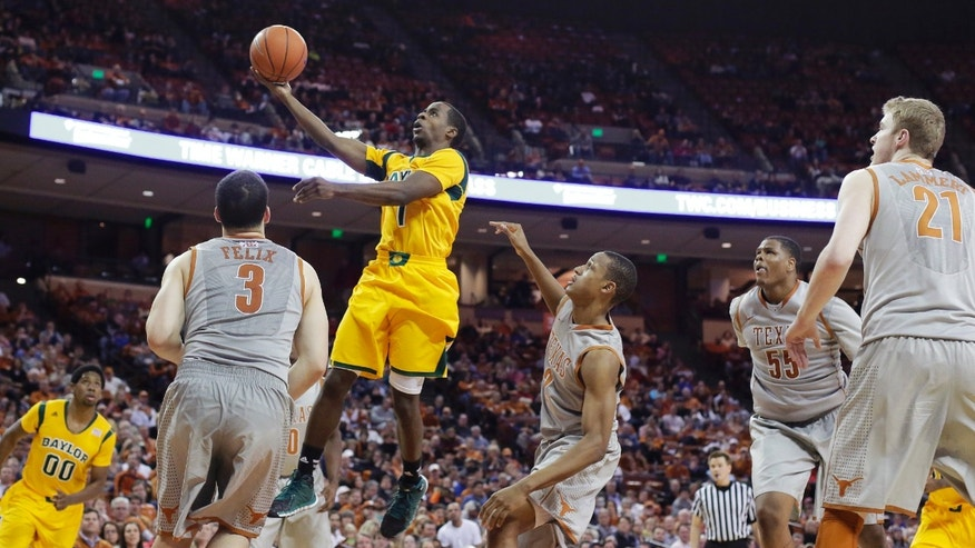 Baylor's Kenny Chery (1) shoots over Texas' Javan Felix (3) during the second half of an NCAA college basketball game, Wednesday, Feb. 26, 2014, in Austin, Texas. Texas won 74-69. (AP Photo/Eric Gay)