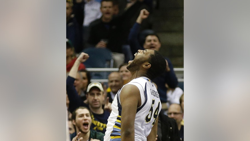 Marquette's Davante Gardner reacts after scoring and being fouled by a Georgetown player during the second half of an NCAA college basketball game on Thursday, Feb. 27, 2014, in Milwaukee. (AP Photo/Jeffrey Phelps)