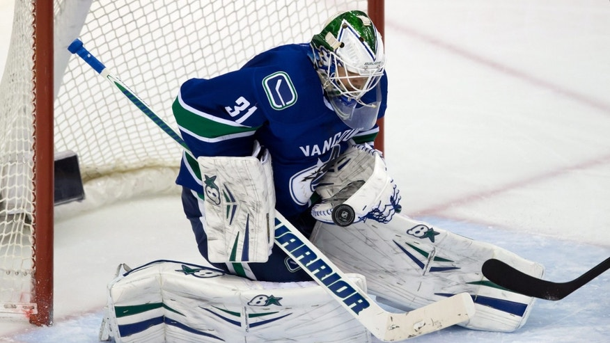 Vancouver Canucks' goalie Eddie Lack, of Sweden, makes a save against the St. Louis Blues during second period NHL hockey action in Vancouver, British Columbia on Wednesday, Feb. 26, 2014. (AP Photo/The Canadian Press, Darryl Dyck)
