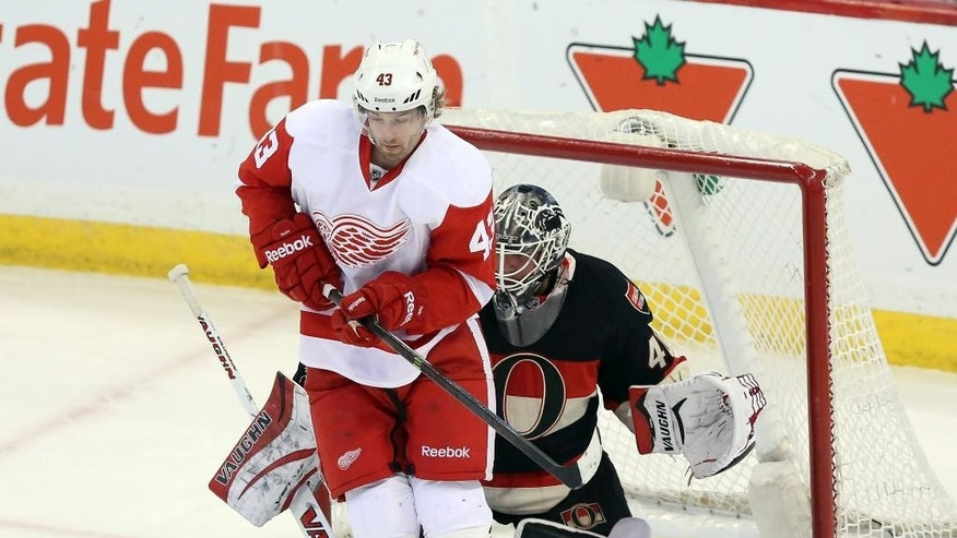 Detroit Red Wings' Darren Helm (43) screens Ottawa Senators goaltender Robin Lehner (40) as teammate Johan Franzen (not shown) scores during first period NHL hockey action in Ottawa, Thursday, Feb. 27, 2014. (AP Photo/The Canadian Press, Fred Chartrand)