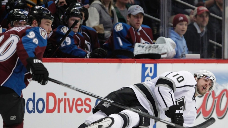 Los Angeles Kings center Mike Richards (10) falls as Colorado Avalanche center Ryan O'Reilly (90) skates up ice in the second period of an NHL game on Wednesday, Feb. 26, 2014 in Denver. (AP Photo/Joe Mahoney)
