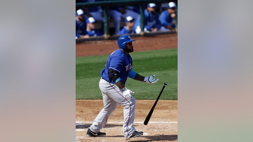 Texas Rangers' Prince Fielder watches the flight of his home run over the right field fence off a pitch from Kansas City Royals' Danny Duffy in the third inning of an exhibition baseball game on Thursday Feb. 27, 2014, in Surprise, Ariz. (AP Photo/Tony Gutierrez)