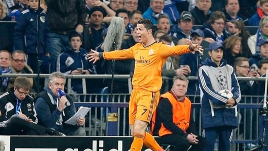 Real's Cristiano Ronaldo celebrates his side's third goal during the Champions League round of the last 16 first leg soccer match between Schalke 04 and Real Madrid in Gelsenkirchen, Germany, Wednesday, Feb.26,2014. (AP Photo/Frank Augstein)