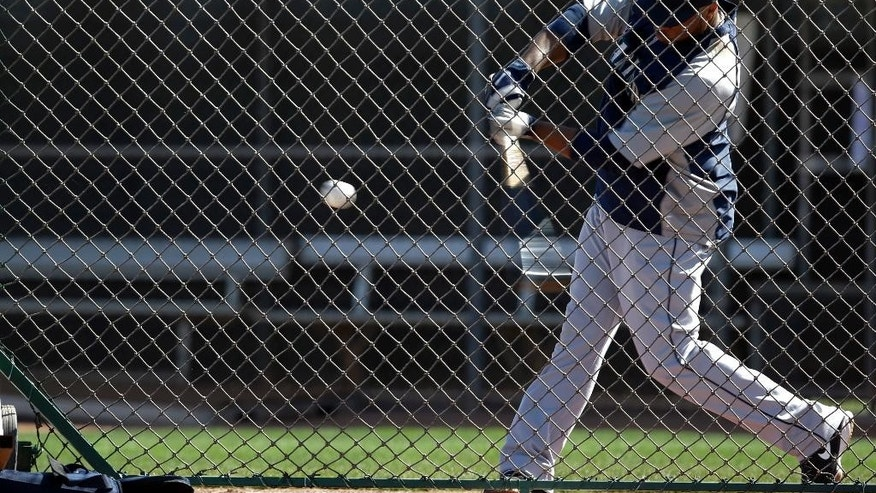 Seattle Mariners' Robinson Cano takes a swing as he participates in batting drills during baseball spring training, Wednesday, Feb. 26, 2014, in Peoria, Ariz. (AP Photo/Tony Gutierrez)