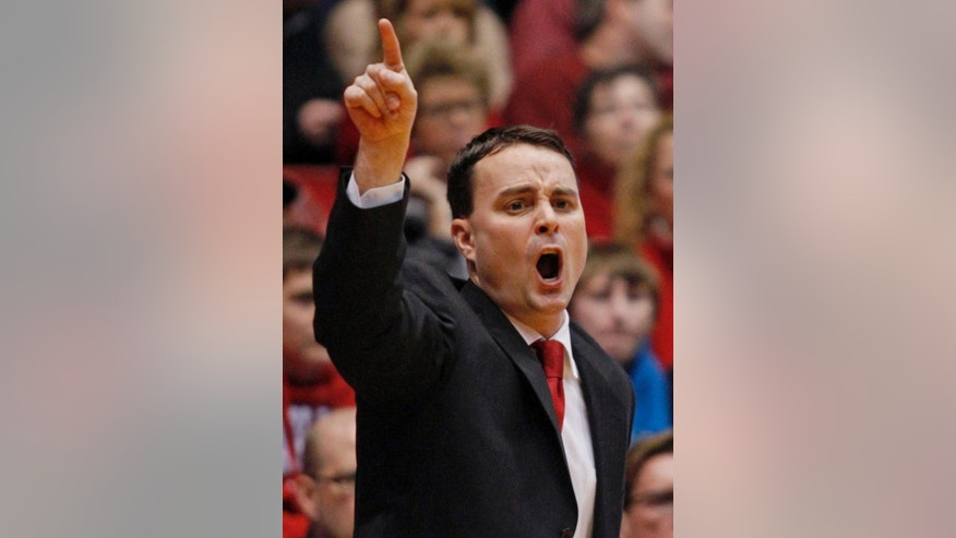 FILE - This  Dec. 22, 2013 file photo shows Dayton coach Archie Miller shouting to his team during an NCAA college basketball game in Dayton, Ohio. Dayton will host the NCAA First Four games this season and the NCAA has ruled that if Dayton is ruled eligible to be one of the First Four teams that they would be allowed to play on their home court. (AP Photo/Skip Peterson, File)