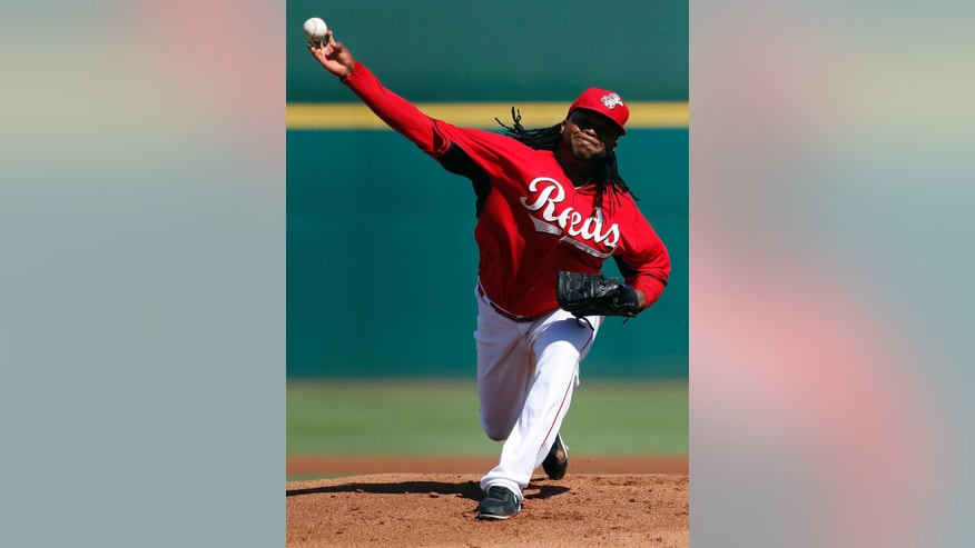 Cincinnati Reds pitcher Johnny Cueto throws against the Cleveland Indians in the first inning of during an exhibition baseball game in Goodyear, Ariz., Thursday, Feb. 27, 2014. (AP Photo/Paul Sancya)