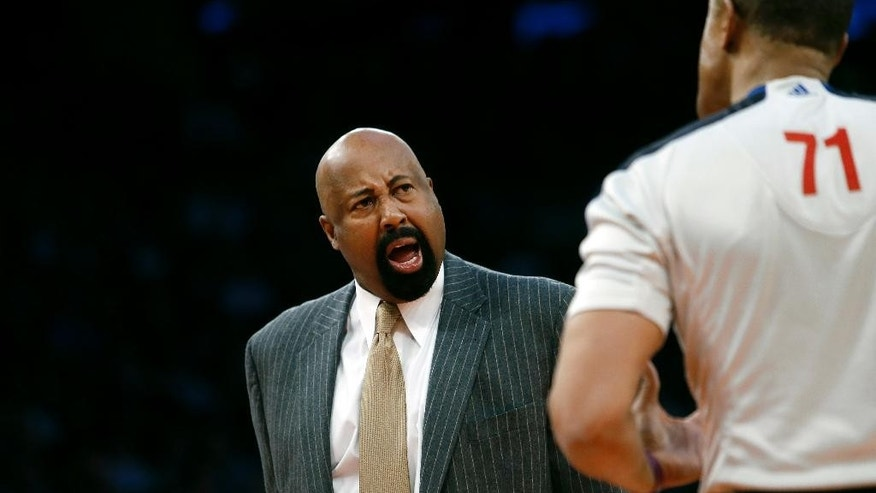 New York Knicks coach Mike Woodson argues with an official during the second half of an NBA basketball game against the Dallas Mavericks, Monday, Feb. 24, 2014, in New York. Dallas won 110-108. (AP Photo/Jason DeCrow)