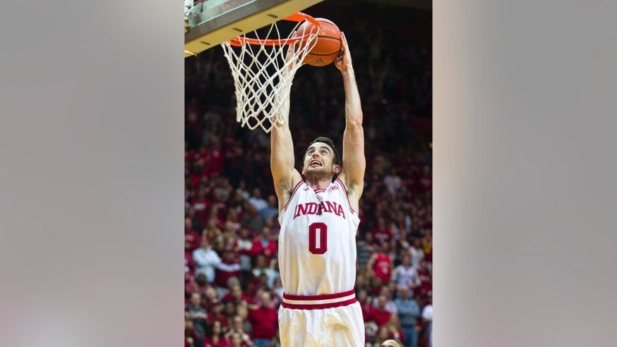 Indiana's Will Sheehey (0) takes the ball to the basket for a slam dunk in the second half of an NCAA college basketball game, Thursday, Feb. 27, 2014, in Bloomington, Ind. Indiana defeated Iowa 93-86. (AP Photo/Doug McSchooler)