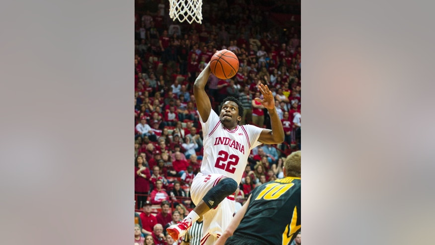 Indiana's Stanford Robinson (22) drives the ball to the basket in the second half of an NCAA college basketball game, Thursday, Feb. 27, 2014, in Bloomington, Ind. Indiana defeated Iowa 93-86. (AP Photo/Doug McSchooler)
