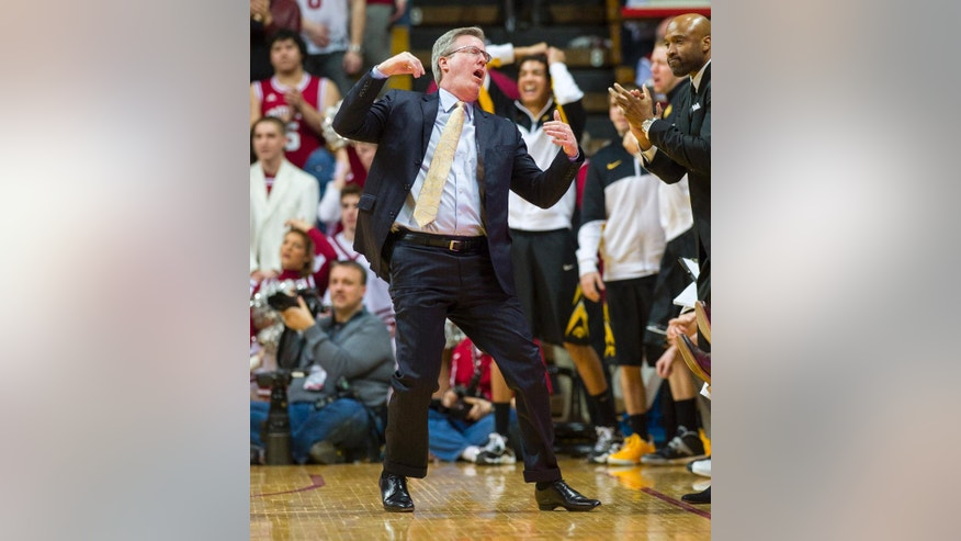 Iowa head coach Fran McCaffery reacts to a call on the floor in the first half of an NCAA college basketball game against Indiana, Thursday, Feb. 27, 2014, in Bloomington, Ind. (AP Photo/Doug McSchooler)